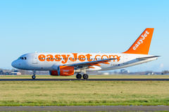 Airplane from easyJet G-EZAK Airbus A319-100 is taking off at Schiphol airport. Stock Images