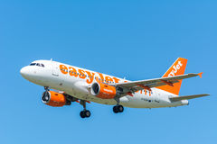 Airplane easyJet G-EZFR Airbus A319-100 is flying to the runway. Royalty Free Stock Photography