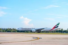 Airplane of Emirates airline is landing in Phuket international airport. PHUKET, THAILAND - 24 APR 17: Airplane of Emirates airline is landing in Phuket Royalty Free Stock Photos