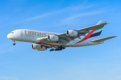 Airplane Emirates A6-EOO Airbus A380-800 is landing at Schiphol airport. Royalty Free Stock Photography