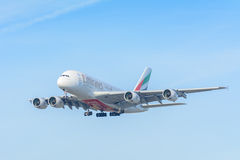 Airplane Emirates A6-EOO Airbus A380-800 is landing at Schiphol airport. Stock Photography