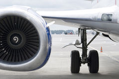 Airplane Engine. Airplane jet engine and chassi view from side Stock Photography