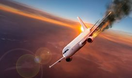 Airplane with engine on fire, concept of aerial disaster. Commercial airplane with engine on fire, concept of aerial disaster royalty free stock photography