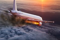 Airplane with engine on fire, concept of aerial disaster. Commercial airplane with engine on fire, concept of aerial disaster stock photo