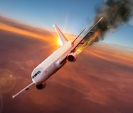 Airplane with engine on fire, concept of aerial disaster. Commercial airplane with engine on fire, concept of aerial disaster royalty free stock images