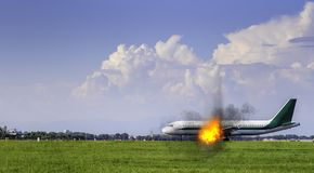 Airplane engine on fire at taxiway - digital manipulation disaster concept royalty free stock photos
