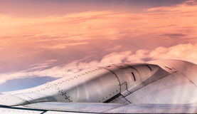 Airplane engine over sunset clouds view from airplane window. Fi Royalty Free Stock Photos