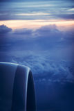 Airplane engine view from window with beautiful sky at sunrise during flight Royalty Free Stock Images