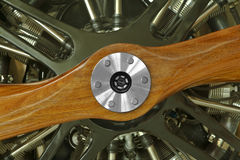 Airplane Engine Wood Propeller. This is a close up view of a vintage airplane engine with a wood propeller Stock Photo