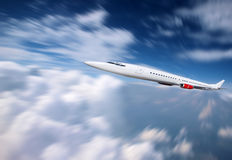Airplane in fast fligh stock photography