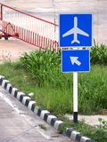 Airplane figure and arrow on blue sign plates Royalty Free Stock Image