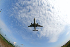 Airplane in fisheye. Stockphoto of an airplane shot with fisheye lens from below Royalty Free Stock Photos