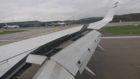 Airplane flaps tilted downward during landing stock video