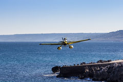 Airplane flies close to the sea stock image