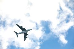 Airplane flies over the city royalty free stock photography