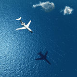 Airplane flies over a sea Royalty Free Stock Photography