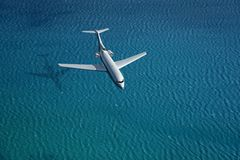 Airplane flies over a sea Stock Photos