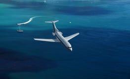 Airplane flies over a sea Royalty Free Stock Photos