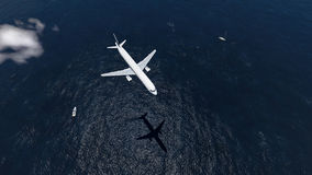 Airplane flies over a sea Stock Photography