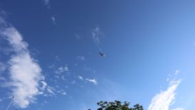 Airplane flies overhead on blue sky. And white clouds stock video