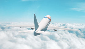 Airplane flies in the sky. Airplane flies on clouds in the sky Royalty Free Stock Photos