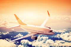 Airplane in flight. A big passenger or cargo aircraft, airline above clouds. royalty free stock photos