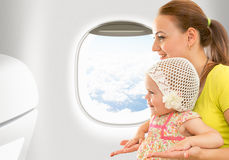 Airplane flight from inside. Woman and kid Stock Photo