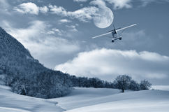 Airplane in flight in mountain Royalty Free Stock Image