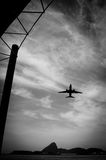 Airplane in flight over the city of Rio de Janeiro Royalty Free Stock Images