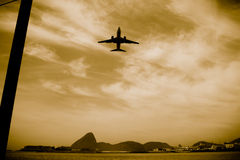 Airplane in flight over the city of Rio de Janeiro Royalty Free Stock Image