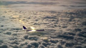 Airplane flight over the clouds stock video footage