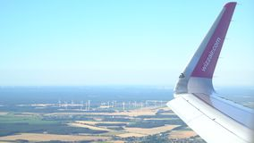 Airplane in flight over the Europe. Windmills in background. Magdeburg, Germany. 30.09.2018 stock video footage