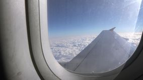 Airplane flight. Wing flying above the clouds of the aircraft . Travelling by air. stock footage