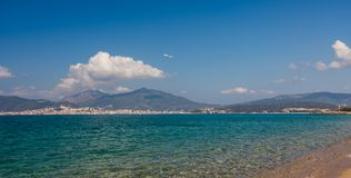 The airplane fly above the Corsica beach. Ajaccio city in the background, with Corsica mountains. royalty free stock images