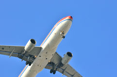 Airplane fly on blue sky Royalty Free Stock Photo