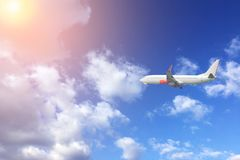 Airplane fly in the blue sky with sun.  Travel concept. Airplane fly in the blue sky with sun.  Travel and transport concept Royalty Free Stock Photos