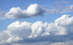 Airplane fly through Blue sky and white Cumulus  cloud. Airplane, Blue sky and white Cumulus  cloud, Cloudscape on Sunny day. Cumulus cloud Stock Images