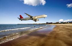 Airplane fly over beach Royalty Free Stock Images