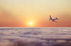 Airplane fly over clouds Stock Photography