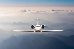 Free Airplane Fly Over Clouds And Alps Mountain On Sunset. Front View Of A Big Passenger Or Cargo Aircraft, Business Jet Stock Photos - 69377813