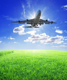 Airplane fly over grass stock image