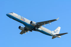 Airplane Flybe G-FBEG Embraer ERJ-195 is taking off at Schiphol airport. Stock Photography