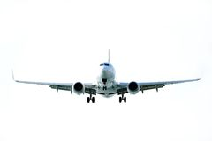 Airplane flying Stock Images