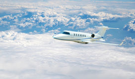 Airplane flying. Airplane fliying on the beautiful blue sky background Royalty Free Stock Images