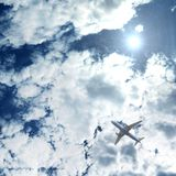 An airplane flying above blue clouds royalty free stock photos