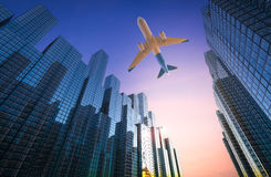 Airplane flying above building. 3d rendering airplane flying above building Stock Images
