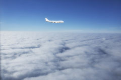 Airplane flying above cloud Stock Photography