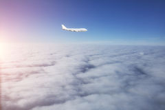 Airplane flying above cloud Royalty Free Stock Photography