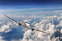 Airplane Flying above the clouds Royalty Free Stock Photos