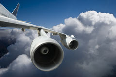 The Airplane flying above clouds Stock Photo